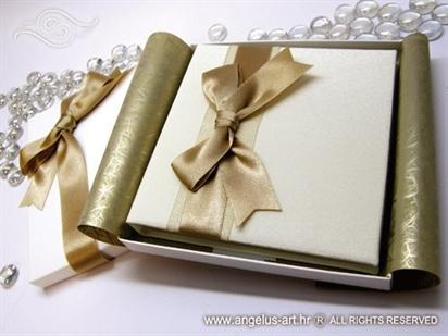 bijela cestitka tvrdih korica s zlatnom satenskom masnom