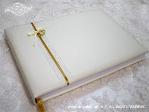 bijela knjiga gostiju za vjenčanje s mrežom i dva zlatna prstena