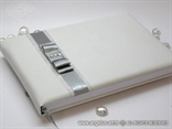 white wedding guest book with silver bow