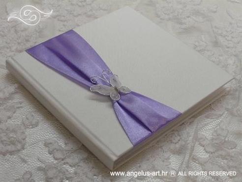 bijelo ljubičasta knjiga za vjenčano prstenje s leptirom