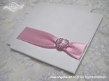 wedding invitation with a heart shaped brooch