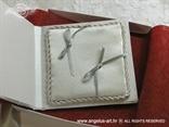 jastučić za prstenje iznutra sa srebrnim mašnicama