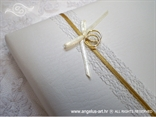 knjiga dojmova s dva zlatna prstenčića