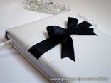 knjiga gostiju na vjenčanju s crnom velikom mašnom