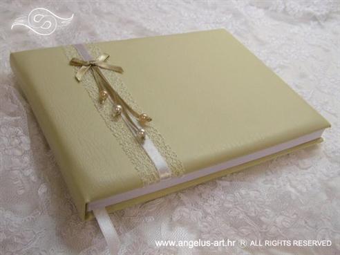 krem knjiga s perlicama i mašnicom za vjenčanje