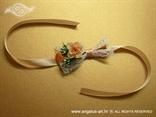 narukvica kao kitica za vjenčanje s narančastom ružom i breskva trakom