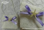 pletena bijela torbica s morskom zvijezdom i mašnicom